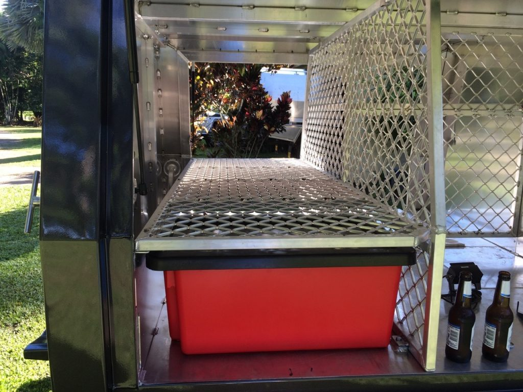 showing framework and storage of the removable Nally bins 79 series dual cab