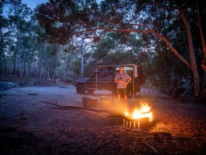 Campfire beside a vehicle