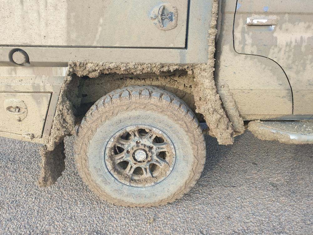 Vehicle Tyre Covered with dried mud