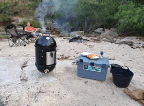 Webber bullet smoker with Expedition 134 camping storage box